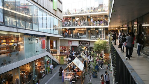 Multiple floors of stores in an outdoor shopping area in Seoul
