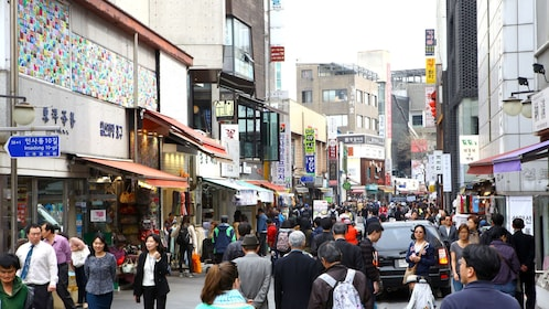Bustling street with shops in Seoul