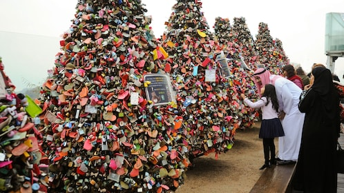 Love lock covered tree structures at the North Seoul Tower