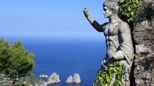 Ancient statue in cliffside of Capri Island