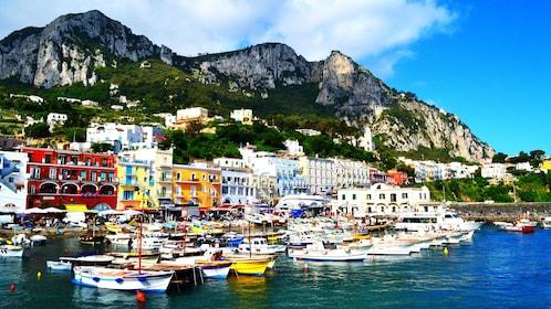 Boats moored in city on Capri island