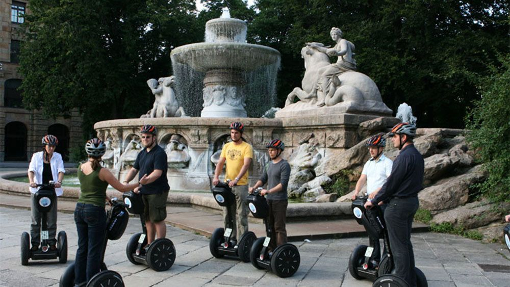 Segway group next to a fountain in Munich