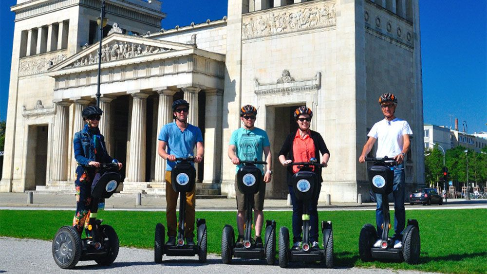 Segway group in front of the Propylaea city gate in Munich