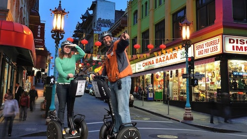 Segway tour on a street in Chinatown at night in San Francisco