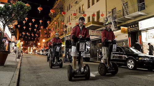 Segway group on a street in Chinatown at night in San Francisco
