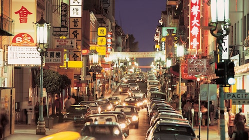 Busy street in Chinatown at night in San Francisco