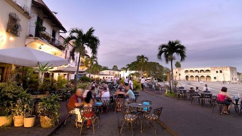 Outside dining at dusk in Santo Domingo