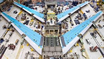 Show item 2 of 10. Air plane wings being built at the Boeing factory in seattle