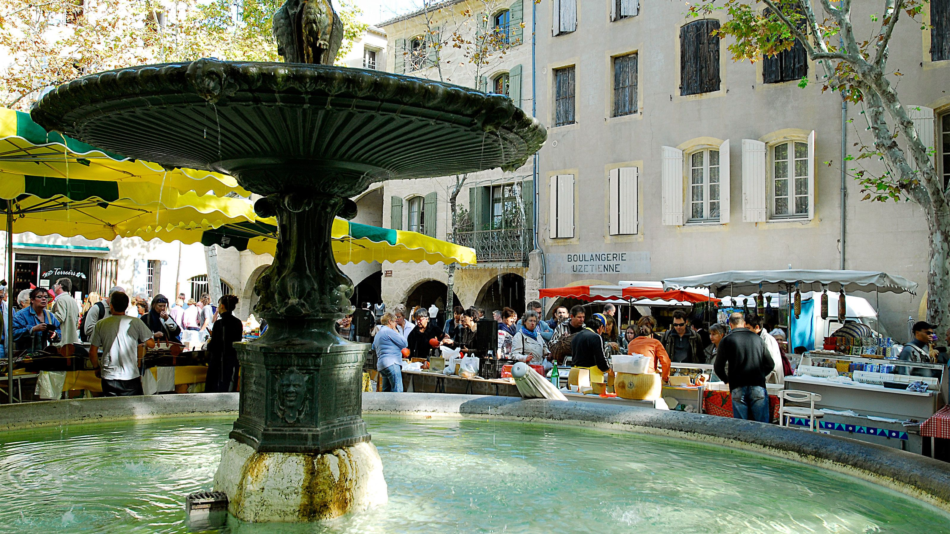 water fountain amidst the outdoor market in France