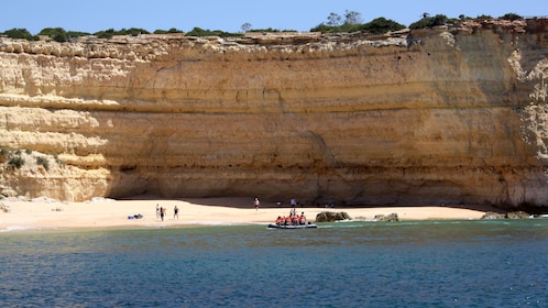Tour group on a small secluded beach in Algarve
