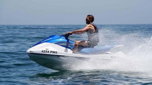 Jet skiing man off the coast of Algarve