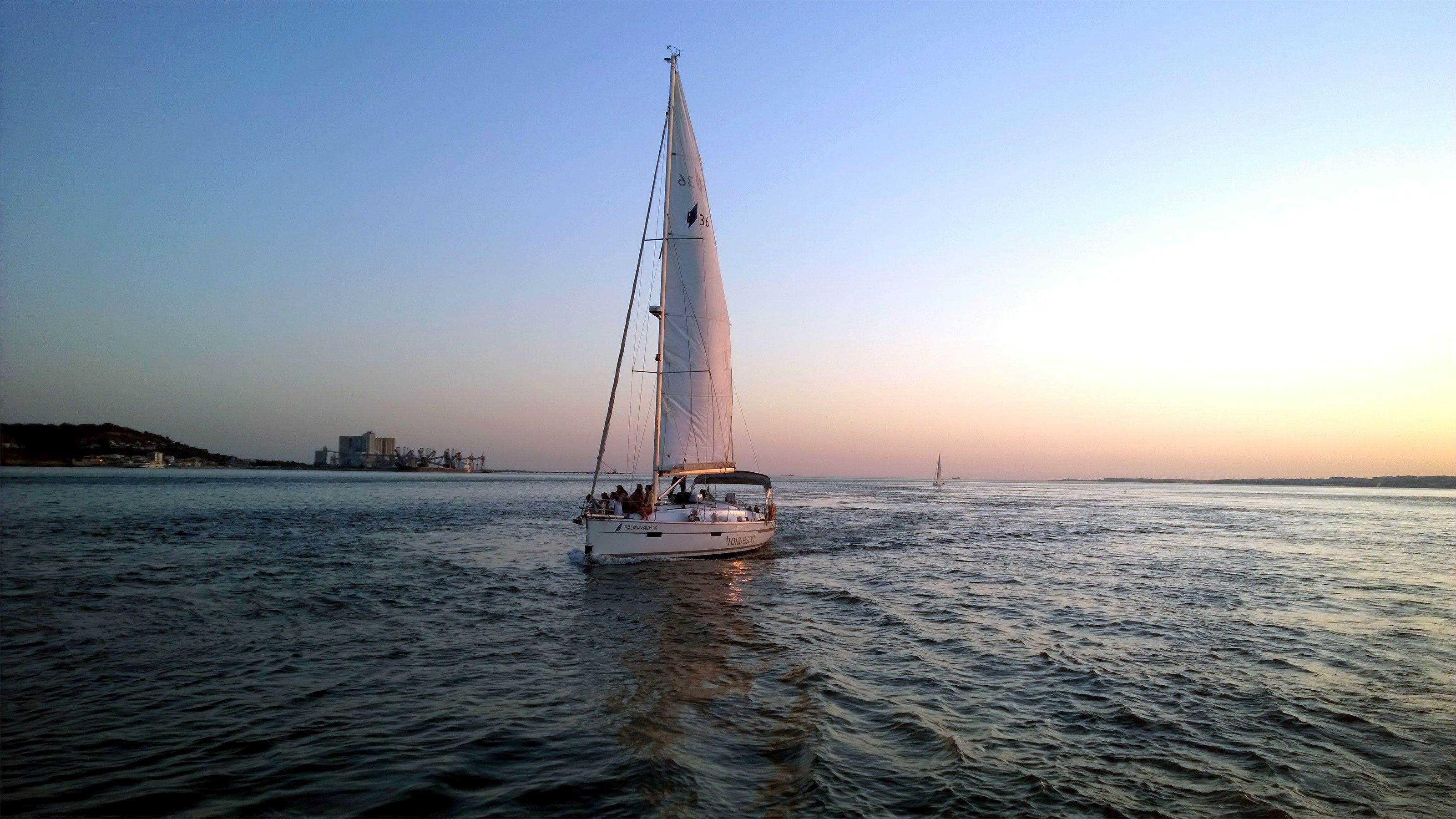 Sailboat at sunset in Lisbon