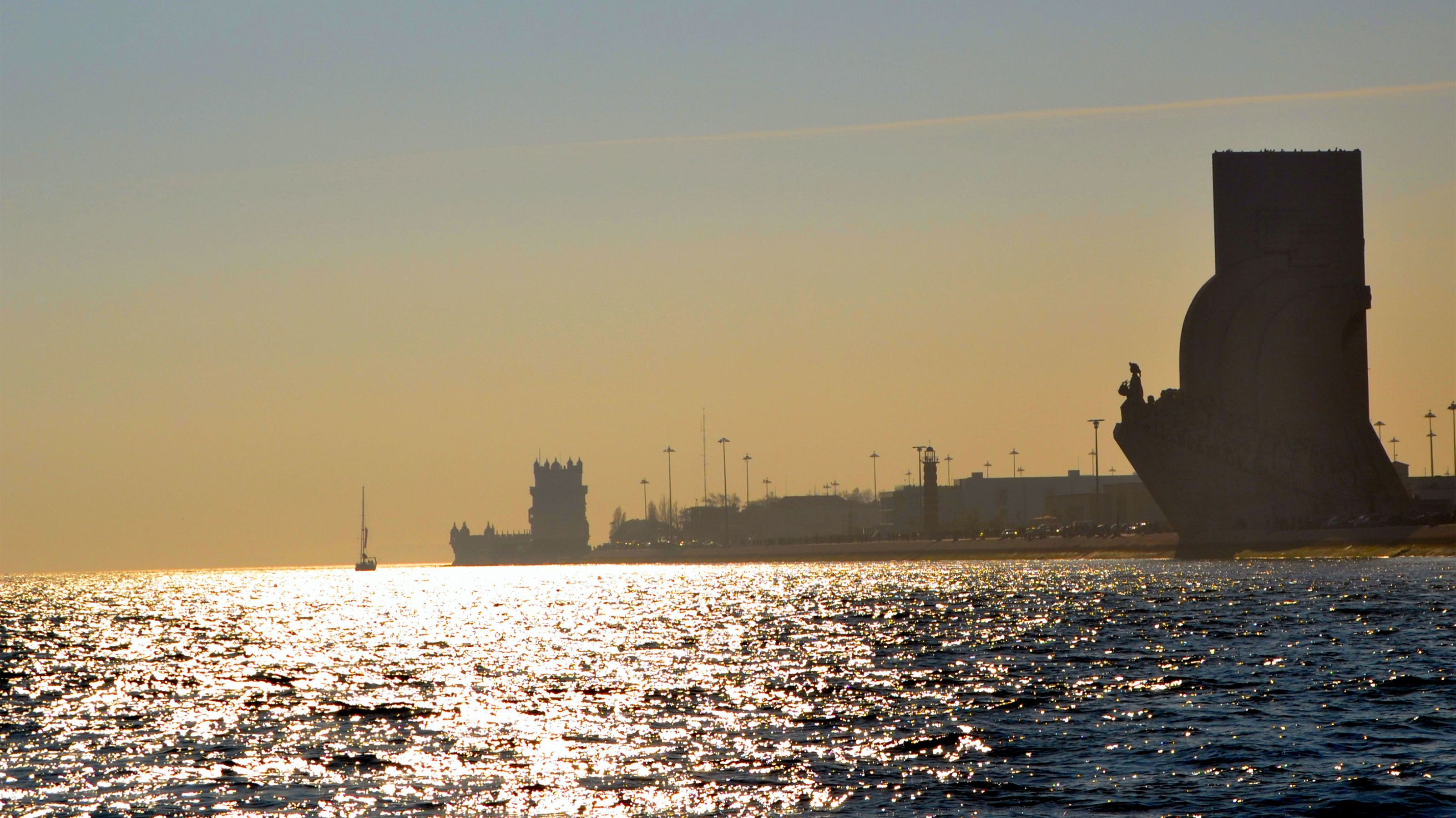 Silhouettes of the Monument to the Discoveries and Belem Tower on the Tagus RIver in Lisbon