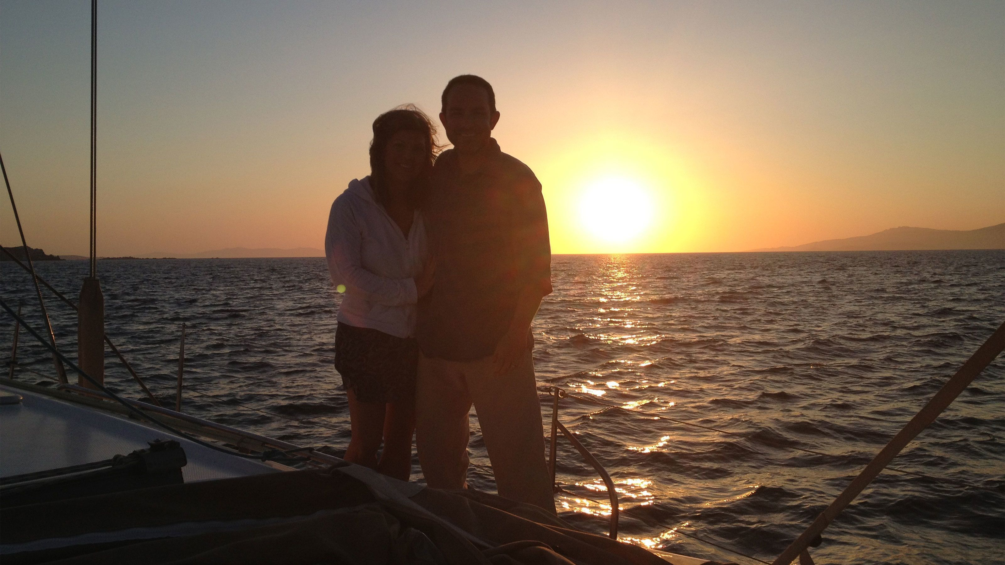 Couple at sunset on a cruise in Mykonos