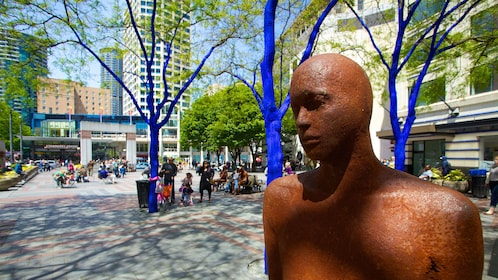 statue next to painted trees in Downtown Seattle