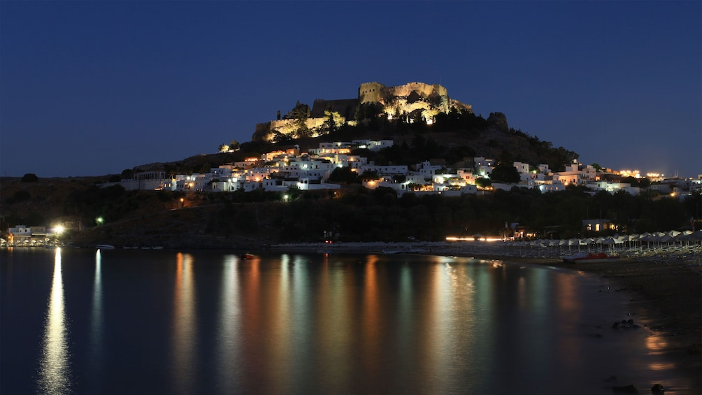 castle on top of the hill at night in Rhodes