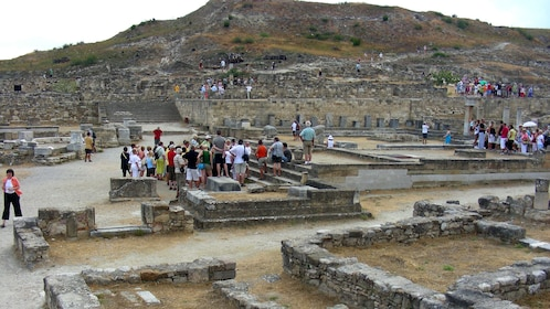 group of visitors at the ruins of Kameiros in Rhodes