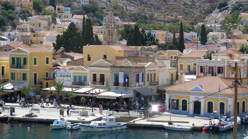 crowded beachfront businesses on Symi Island