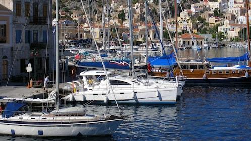 boats docked along the bay in Symi Island