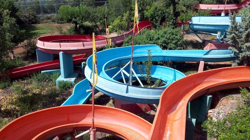Show item 2 of 8. colorful coiling waterslides at the waterpark in Greece