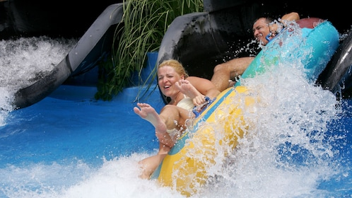 couple at the bottom of the water slide at the waterpark in Greece