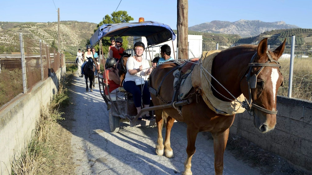 riding on a horse drawn carriage in Crete