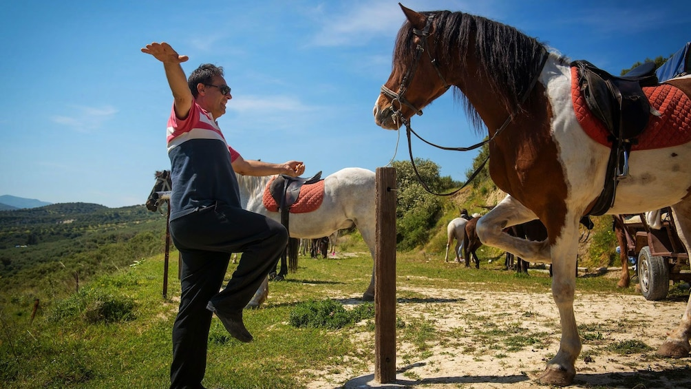 man performing tricks with a horse in Crete