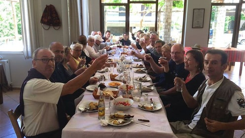 Group having lunch with wine in Greece