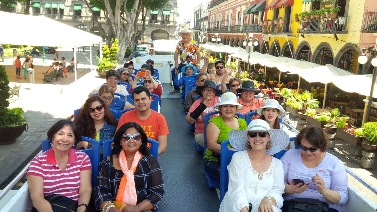 Tourists on double decker tour bus in Puebla