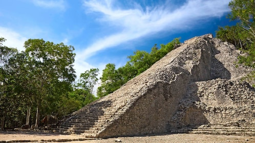 Ruins of Nohoch Muul Pyramid and surrounding trees in Coba