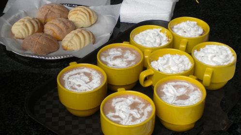 Whipped cream-topped cups of coffee with fresh pastries at a cafe in Los Angeles