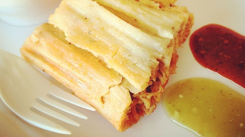 Fresh tamale with salsa at restaurant in Los Angeles