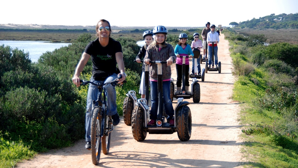 Show item 1 of 6. Group of people riding segways at a natural park in Algarve