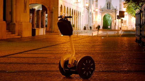 Segway on a cobblestone street at sunset in Algarve