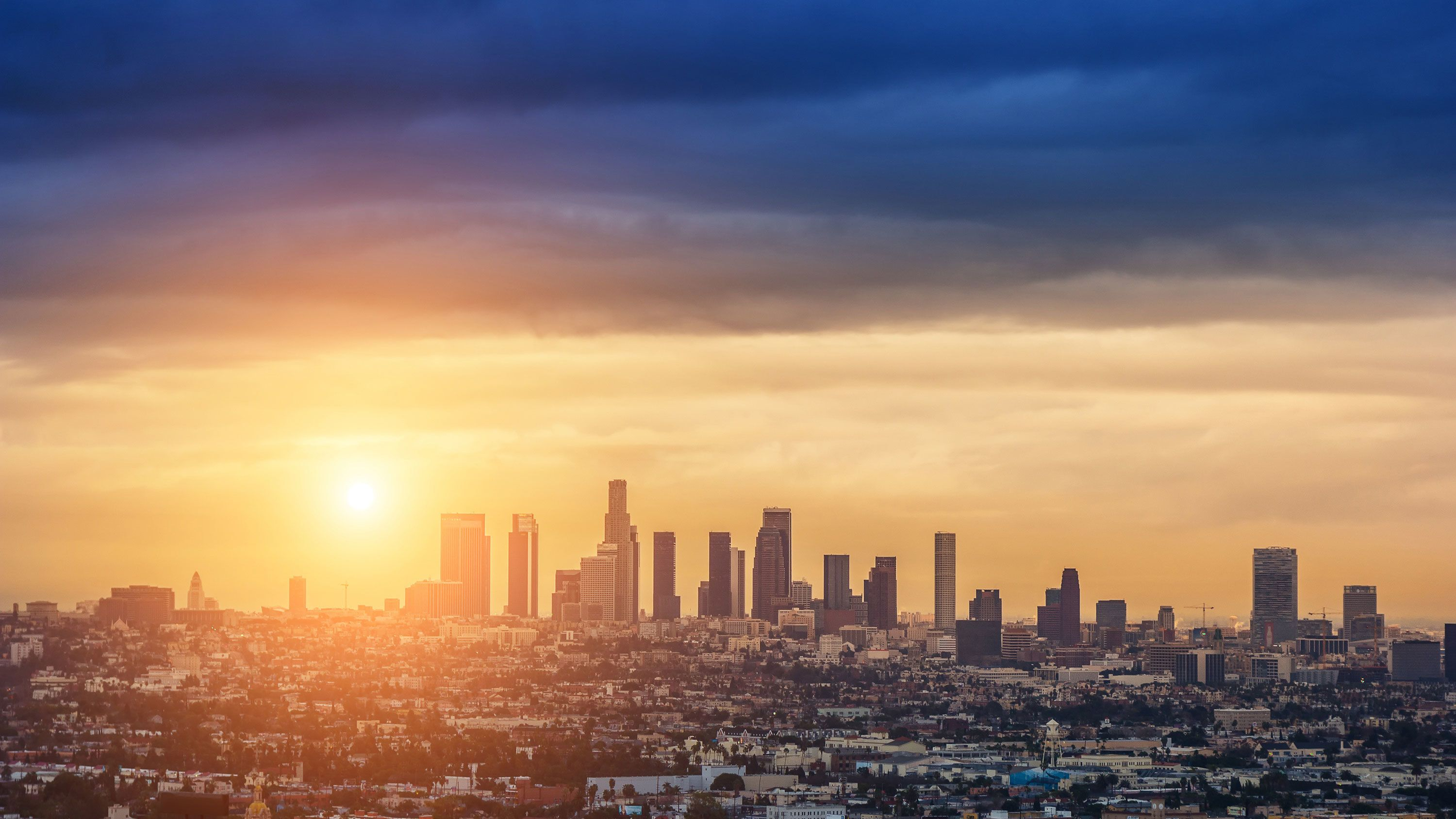 Distant view of the Los Angeles skyline at sunset