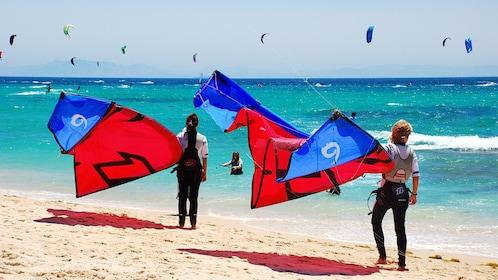 Pair of kitesurfers on the beach on Mallorca Island