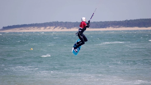 Kitesurfing catching air over the water on Mallorca Island