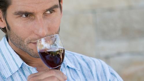 Man drinking wine in Boston