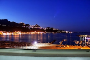 Romantic dinner on board from Giardini Naxos