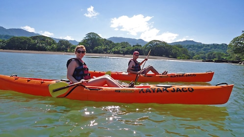 Couple kayaking along each other in Jaco