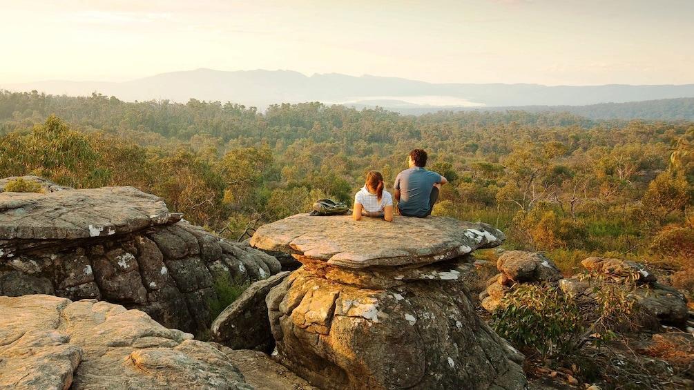 Show item 3 of 10. Couple sitting on mushroom shaped rocks at Grampians National Park