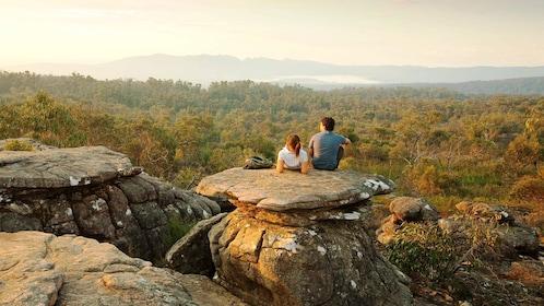 Couple sitting on mushroom shaped rocks at Grampians National Park