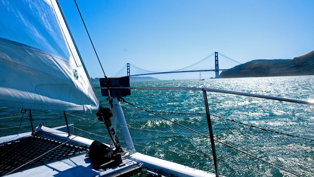 Show item 3 of 10. Boat near Bridge in San Francisco