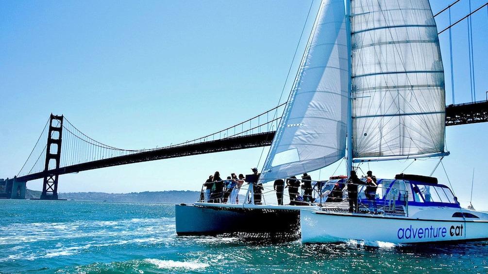 Show item 2 of 10. Boat near Bridge in San Francisco