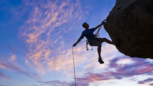 Rock climbing instructor repelling in San Francisco