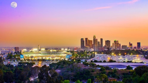 Baseball stadium and Los angeles skyline at sunset