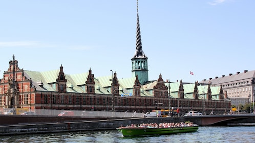 boat sailing past Christiansborg Palace in Copenhagen