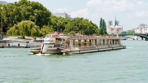 River boat sailing down the Seine river in Paris