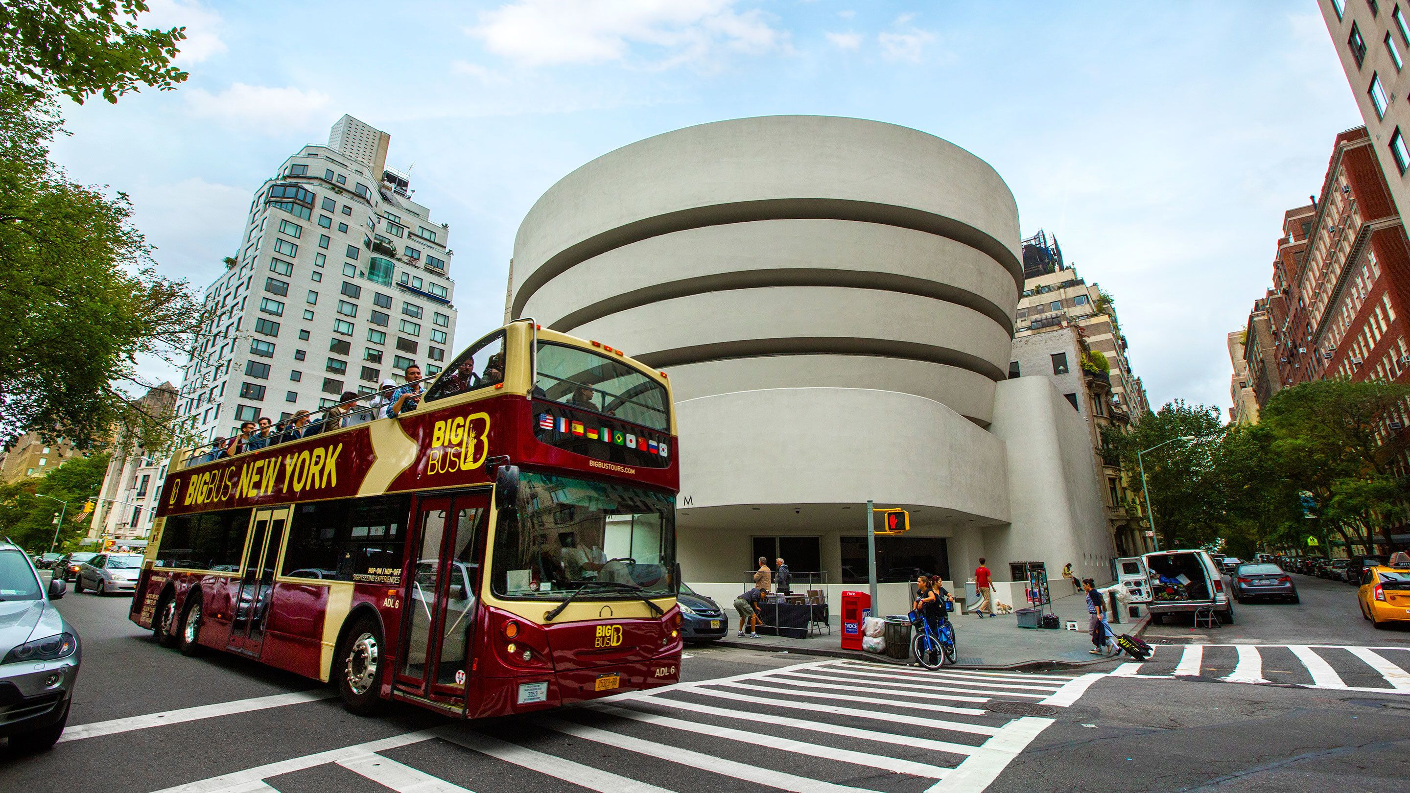 Double decker tour bus driving past the Guggenheim in New York City