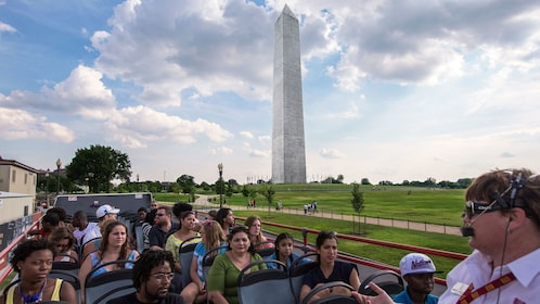Upper level of a tour bus with the Washington Monument in the background in Washington DC
